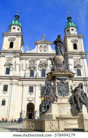 Catholic church (Cathedral) and tall statue in Salzburg, Austria