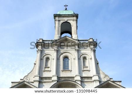 Catholic church exterior with cross - stock photo
