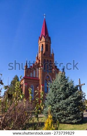 Catholic Church  in Gothic Revival style in Stolovichi (Stolowiczy), Belarus. - stock photo