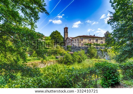 Catholic church of medieval village nestled in the green hills of Romagna