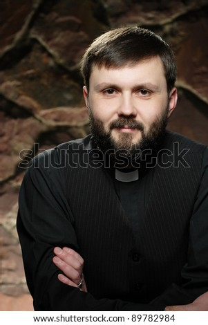Catholic priest at morning prayer - stock photo