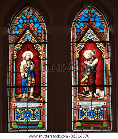 Catholic stained glass window from a church. - stock photo