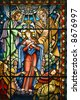 Catholic stained glass window from a church of the north of Portugal - stock photo