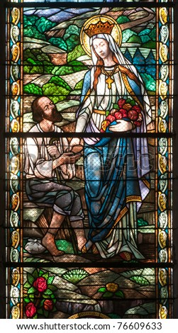 Catholic stained glass window from a church of the north of Serbia - stock photo