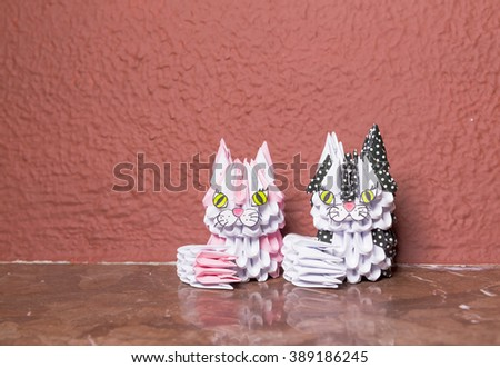 cats from paper, man and woman - stock photo