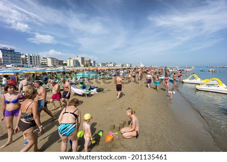 CATTOLICA, ITALY - JUNE 23: crowd of people on the beach on June 23, 2014 in Cattolica, Emilia Romagna, Italy. At the start of the summer the beach of Riviera Romagnola gets full of people - stock photo