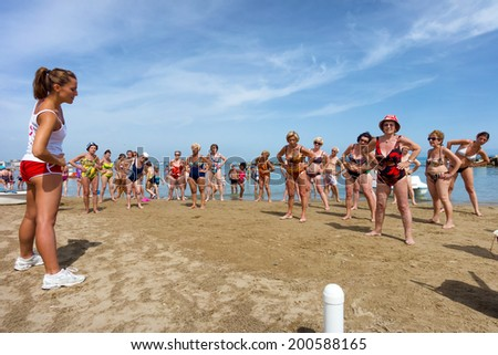 CATTOLICA, ITALY - JUNE 23: fitness on the beach on June 23, 2014 in Emilia Romagna, Italy. Like every year, at the start of the summer the Riviera Romagnola is one of the favourite place for seniors - stock photo