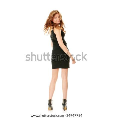 Catwalk fashion model posing isolated over a white background - stock photo