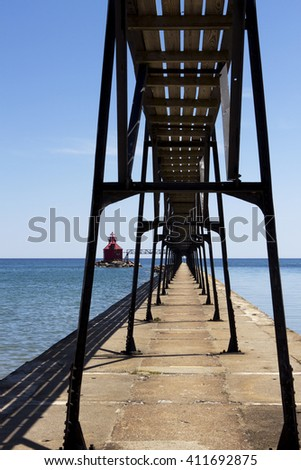Catwalk leading to the beacon at the entrance to Sturgeon Bay ship canal in Wisconsin. - stock photo