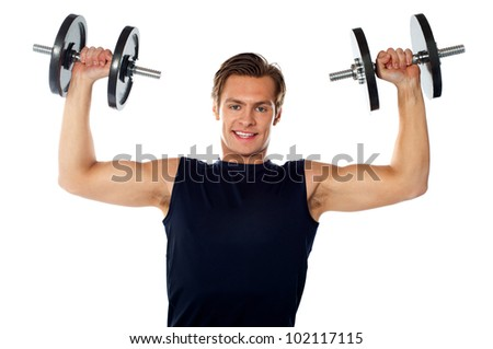 Caucasian athlete exercising in sporty outfits, lifting weights - stock photo