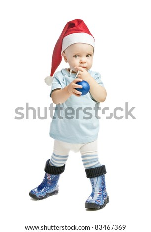 caucasian baby boy in a red christmas cap - stock photo