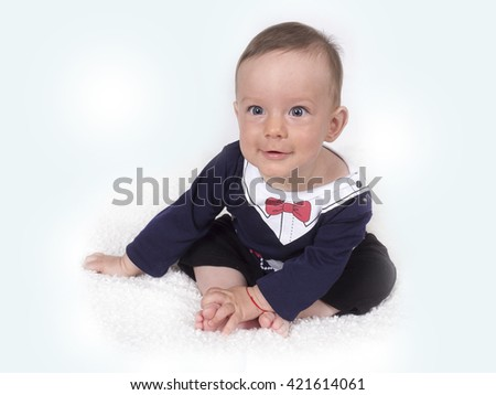 caucasian baby boy with blue eyes - stock photo