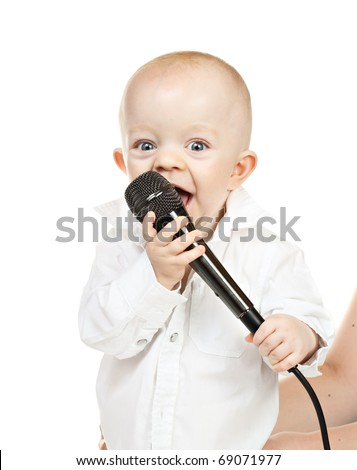 caucasian baby boy with microphone