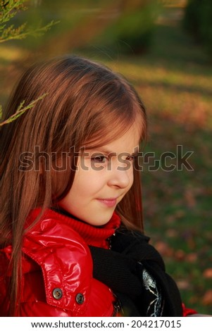 Caucasian beautiful little girl at october month outdoors