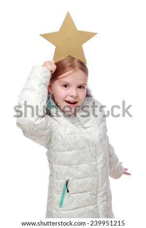 Caucasian beautiful little girl in a white winter down jackets keep the star on a white background - stock photo