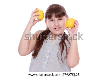 caucasian beautiful little girl with fresh yellow lemons isolated over white background - stock photo