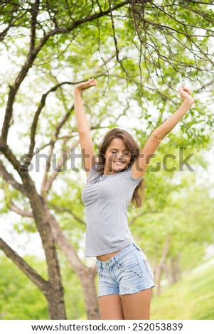 Caucasian beauty enjoying the summer - stock photo