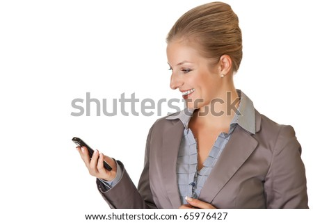 Caucasian blond businesswoman in suit with cell phone on white isolated background