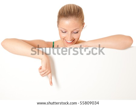 Caucasian blond woman peeping white board - stock photo