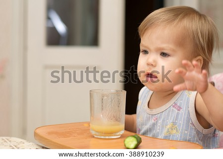 Caucasian blonde little girl expressing  while eating - stock photo