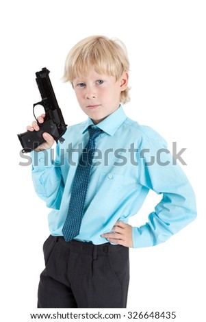 Caucasian boy holding black gun and looking at camera, isolated on white background - stock photo