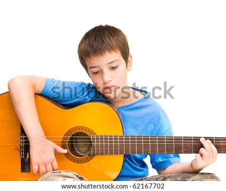 caucasian boy learning to play acoustic guitar; isolated on white background; horizontal crop - stock photo