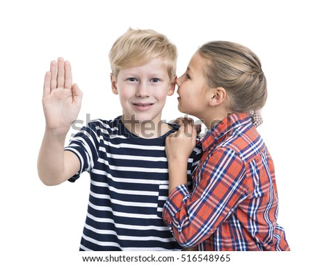 Caucasian boy pushing an imaginary button and girl whispering ear, white background