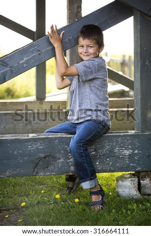caucasian boy smiling and playing in the park - stock photo