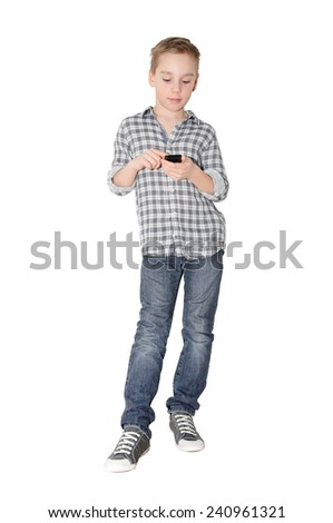 Caucasian boy stands with touch phone on white background