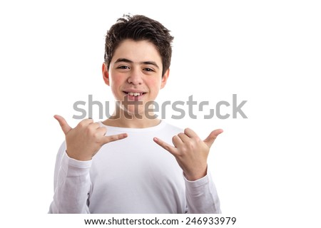Caucasian boy wearing a white long sleeve t-shirt smiles doing Hawaiian shaka, hang loose, gesture with hand - stock photo