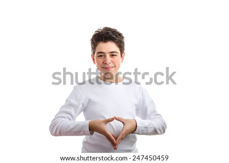 Caucasian boy with acne-prone skin in a white long sleeved t-shirt  smiling makes reverse hand steeple gesture - stock photo