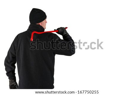 caucasian burglar with a crowbar in his hand - stock photo