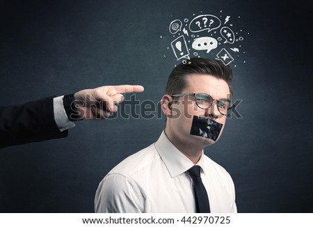 Caucasian business hand pointing at stressed male employee with drawn question, explamation marks, talk bubble above his head - stock photo