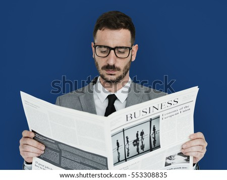 Caucasian Business Man Newspaper