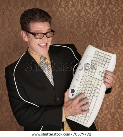 Caucasian business man playing guitar with a computer keyboard - stock photo