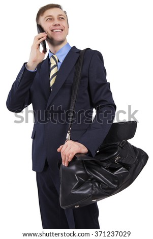 Caucasian business man talking on a smartphone. Telephone communications. Over his shoulder bag. Isolated on white background. - stock photo