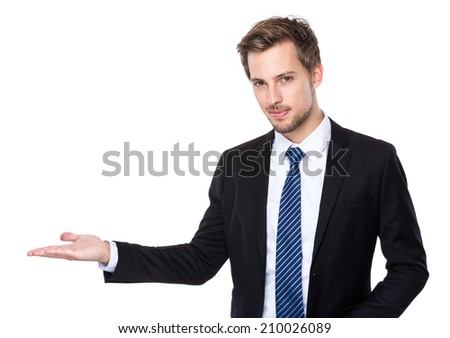 Caucasian business man with hand presentation - stock photo
