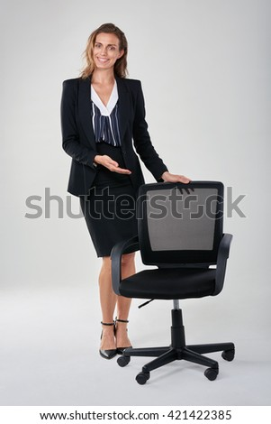 Caucasian business woman showing empty office chair, hiring recruitment vacancy employment concept - stock photo