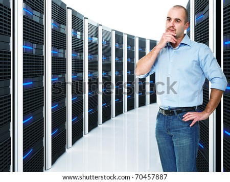 caucasian businessman and  datacenter with lots of server - stock photo