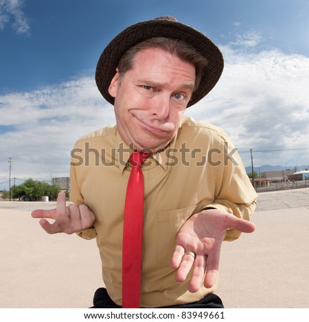 Caucasian businessman in hat with open hands outside - stock photo