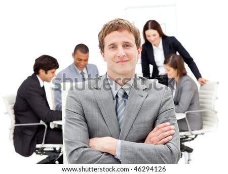 Caucasian businessman sitting in front of his team in a meeting - stock photo