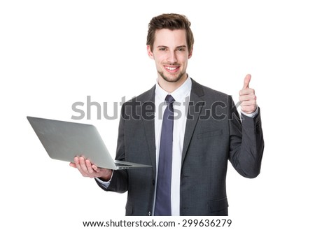 Caucasian businessman use of laptop and thumb up - stock photo