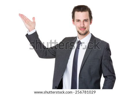 Caucasian businessman with hand present something - stock photo