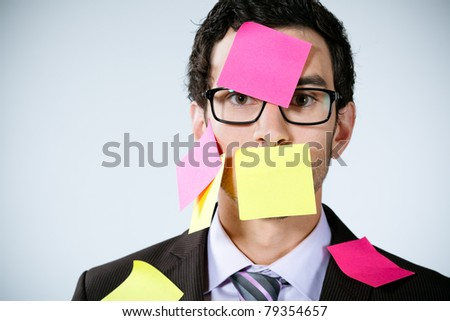 caucasian businessman with post it on his face - stock photo