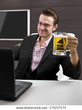Caucasian businessman working with a laptop in an office - stock photo