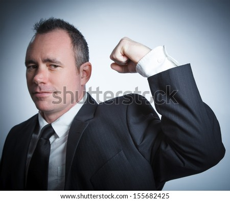 Caucasian businessman 40 years old isolated on a grey background