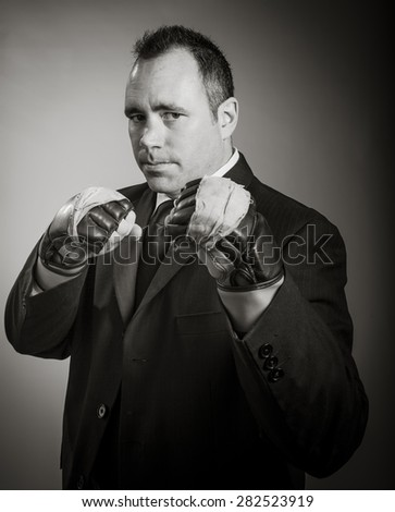 Caucasian businessman 40 years old isolated on a grey background, black and white image - stock photo
