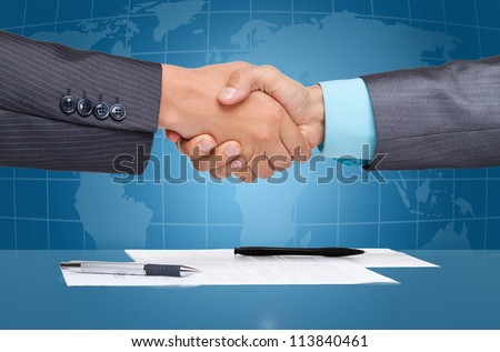 caucasian businessmen handshake after sign up contract, over blue digital world globe map  background, Concept of global international business collaboration, communication - stock photo