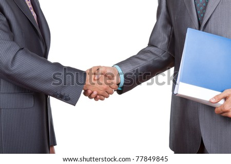 Caucasian businessmen in elegant suits, hold folder, files, documents in hand, handshake isolated on white background, with empty copy space. Communication, greeting, agree, congratulation concept. - stock photo