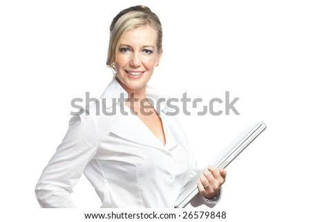 Caucasian businesswoman dressed in business attire holding a laptop - stock photo